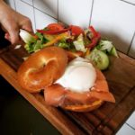 Salmon and poached egg bagel