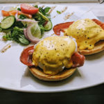 Eggs Benedict, poached eggs over bacon and toasted bread